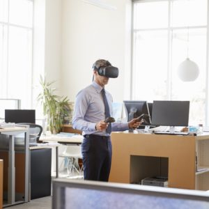 Businessman using VR technology in an office, side view